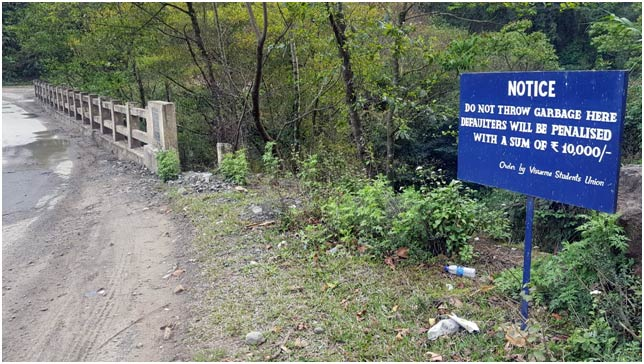 A signboard showing prohibiting of dumping of waste into the rivers and drains at Viswema, Kohima